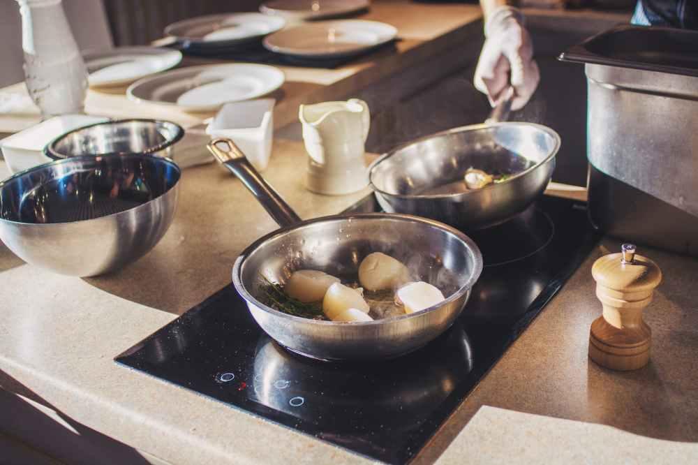 photo of man holding pan